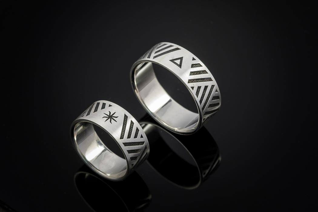 Graviruoti vestuviniai žiedai iš sidabro.